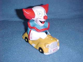 Bozo the Clown in a car Salt & Pepper Shakers. Made by Star Jars - Product Image