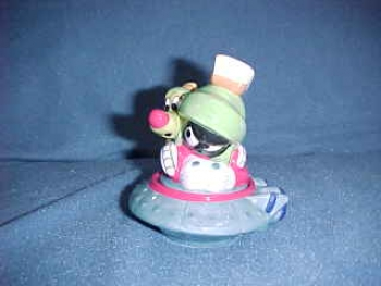 Marvin the Martian and dog K-9 in their Spaceship. Made by Warner Bros. - Product Image